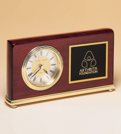 Rosewood Piano Finish Desk Clock on a Brass Base.
